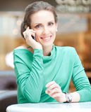 Beautiful business woman talking on cell phone Stock Photography