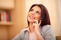 Beautiful business woman talking on cell phone Stock Images