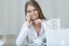 Beautiful business woman talking on mobile phone Royalty Free Stock Photos