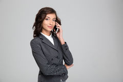 Beautiful business woman talking on mobile phone Stock Photo
