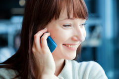 Beautiful business woman talking on mobile phone and smiling Stock Photo