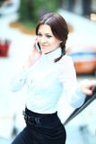 Beautiful business woman talking on mobile phone Royalty Free Stock Photo