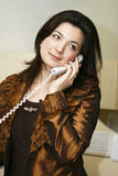Beautiful business woman talking on the phone. Royalty Free Stock Photo
