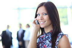 Beautiful business woman talking on phone Royalty Free Stock Photos