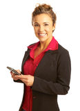 Beautiful business woman text messaging. Beautiful business woman holding cellphone text messaging Royalty Free Stock Photo