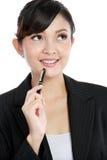 Beautiful business woman thinking Stock Photo