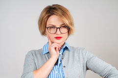 Beautiful business woman thinking of her plans. Royalty Free Stock Image
