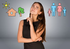 Beautiful business woman thinking over family and Royalty Free Stock Photography