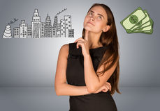 Beautiful business woman thinking over money and Royalty Free Stock Photography