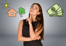Beautiful business woman thinking over money and royalty free stock image