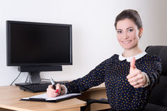 Beautiful business woman thumbs up in office and pc monitor with Royalty Free Stock Photography