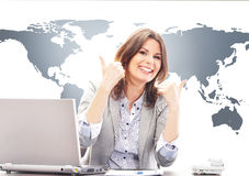 Beautiful business woman with thumbs up in office Stock Image