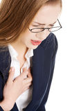 Beautiful business woman touching her chest, feeling unwell. Stock Photos
