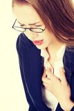 Beautiful business woman touching her chest. Stock Photo