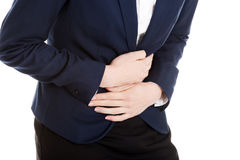 Beautiful business woman is touching her stomach. stock photos