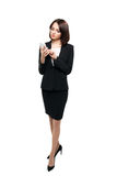 Beautiful business woman typing on her smartphone Stock Photography
