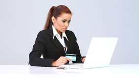 Beautiful business woman using credit card stock video footage