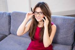 Beautiful business woman using mobile phone Stock Image