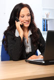 Beautiful business woman using telephone at work Royalty Free Stock Images