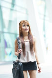 Beautiful business woman walking outside her office with briefca Royalty Free Stock Photo