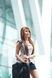 Beautiful business woman walking outside her office with briefca Royalty Free Stock Photography