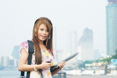 Beautiful business woman walking outside her office. Portrait of Stock Photography