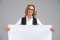 Beautiful business woman with white banner. Stock Photos