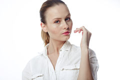 Beautiful business woman in a white shirt, hair in a ponytail Royalty Free Stock Photos