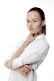 Beautiful business woman in a white shirt, hair in a ponytail Royalty Free Stock Image