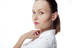 Beautiful business woman in a white shirt, hair in a ponytail Stock Image