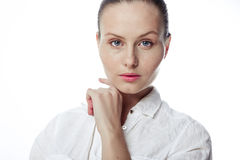 Beautiful business woman in a white shirt, hair in a ponytail Stock Photo