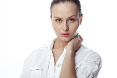 Beautiful business woman in a white shirt, hair in a ponytail Stock Images