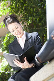 Beautiful Business Woman Working. Low angle view of happy beautiful business woman working Royalty Free Stock Photo