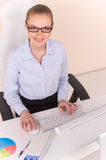 Beautiful business woman working on computer. Stock Images