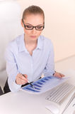 Beautiful business woman working at desk. Royalty Free Stock Photo