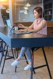 Beautiful business woman working on desk stock photos