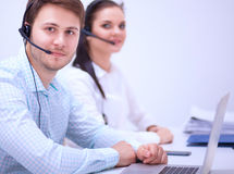 Beautiful business woman working at her desk with headset and laptop Stock Photography