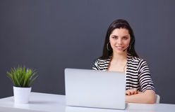 Beautiful business woman working at her desk with Royalty Free Stock Photography