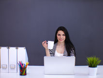 Beautiful business woman working at her desk with Stock Photo