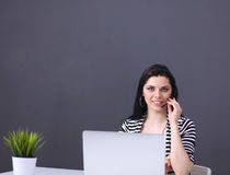 Beautiful business woman working at her desk with Royalty Free Stock Photo