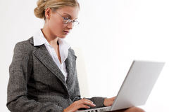 Beautiful business woman working on her laptop Royalty Free Stock Photo