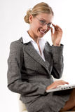 Beautiful business woman working on her laptop. Smiling Stock Photo