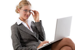 Beautiful business woman working on her laptop Stock Images