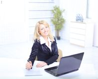 Beautiful business woman working on her laptop Stock Image
