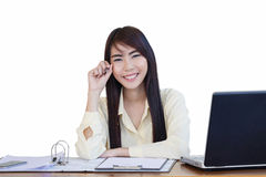 Beautiful business woman working and her pointing with a pen. la Stock Photography