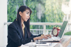 Beautiful business woman working and her typing on laptop keybor Stock Photos