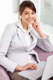 Beautiful business woman working on a laptop Royalty Free Stock Photo