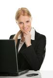 Beautiful business woman working on laptop Stock Photography