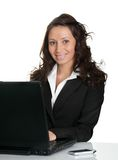 Beautiful business woman working on laptop Stock Images