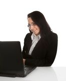 Beautiful business woman working on laptop Royalty Free Stock Images